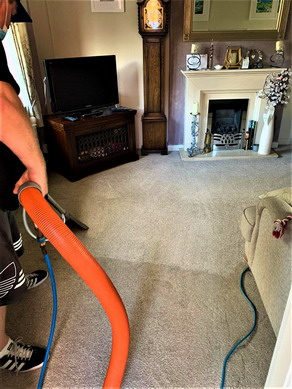 Steam cleaning a carpet in Warrington